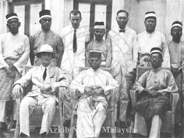 Members of Perak State Council, December, 1925. Seated (Left to Right) : A.S. Haynes, Acting British Resident (or O.F. Stonor?); His Highness Sultan Iskandar Shah; Raja Abdul Aziz (Raja Muda). Standing (Left to Right): ? ; ? ; P.T. Allen, Secretary to Resident; Raja Harun Alrashid (Raja Kechil Sulong); Leong Sin Nam; Raja Chulan. Source: Arkib Negara Malaysia