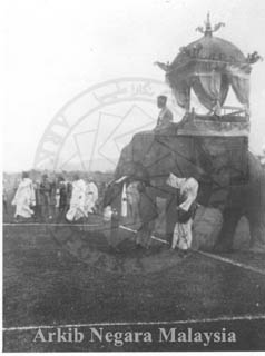 An elephant with a carriage, likely at the 1897 Durbar in Kuala