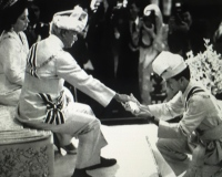 Raja Nazrin Shah (later Sultan) receiving his letter of appoinment as the Regent of Perak at Istana Iskandariah on 19 April 1989. The appoinment took effect from 26 April 1989 when Sultan Azlan Shah was installed as the 9th Yang di-Pertuan Agong for a five-year term.